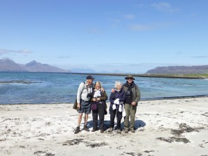 Group on the beach on Muck with views across to Eigg